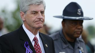 Mississippi, Governor Phil Bryant arrives to attend B.B. King's funeral in Indianola, Mississippi May 30, 2015.  Bryant said on Thursday he planned to join a suit by officials from 11 states to overturn an Obama administration directive that tells schools to let transgender students use bathrooms matching their gender identity.    REUTERS/Mike Blake/File Photo