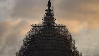 The US Capitol dome is seen on Capitol Hill January 5, 2015 in Washington, DC. US lawmakers return to Washington on January 6 under a new, fully Republican banner after the party swept to victory in November elections. Republican leaders will have plenty on their plate in the first quarter, as the party seeks to roll back President Barack Obama's legislative gains and press its own agenda ahead of the 2016 presidential race. Conservatives are furious at Obama's recent use of executive orders, notably to halt deportations of undocumented immigrants and to begin normalizing US-Cuba relations.  AFP PHOTO/BRENDAN SMIALOWSKI        (Photo credit should read BRENDAN SMIALOWSKI/AFP/Getty Images)
