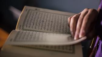 A Muslim woman reads the Quran (Koran).The Quran is the central religious text of Islam, which Muslims believe to be a revelation from God.