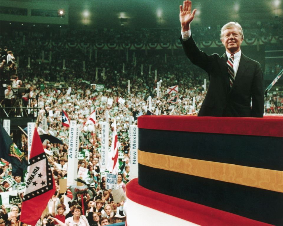 Jimmy Carter waves before the crowd on the floor of the Democratic Convention of 1980. (Photo by © CORBIS/Corbis via Getty I