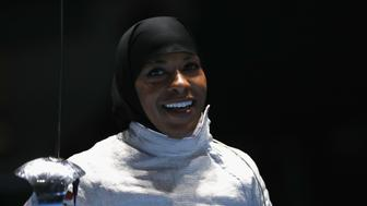 RIO DE JANEIRO, BRAZIL - AUGUST 08:  Ibtihaj Muhammad of the United States celebrates victory over Olena Kravatska of Ukraine during the Women's Individual Sabre on Day 3 of the Rio 2016 Olympic Games at Carioca Arena 3 on August 8, 2016 in Rio de Janeiro, Brazil.  (Photo by Patrick Smith/Getty Images)