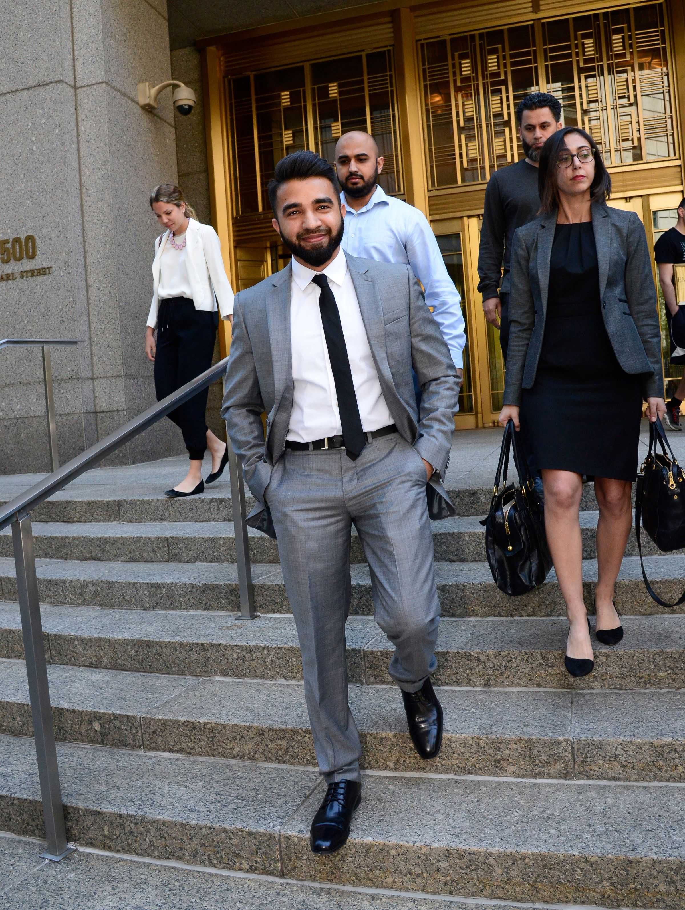 Police Officer Masood Syed (center in suit) leaves Manhattan Federal Court on Wednesday, June 22, 2016. Sayed, a Sunni Muslim, is suing the city for suspending him from the force over the length of his beard. (Photo by Jefferson Siegel/NY Daily News via Getty Images)