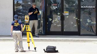 FBI agents continue their investigation at the Armed Forces Career Center in Chattanooga, Tennessee July 17, 2015. Four U.S. Marines were killed on Thursday by a suspected gunman the FBI has confirmed as Mohammod Youssuf Abdulazeez, who opened fire at two military offices in Chattanooga before being fatally shot by police.   REUTERS/Tami Chappell