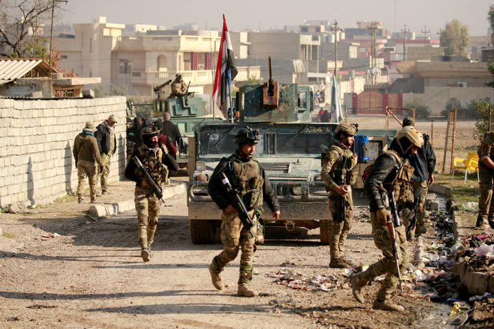 Iraqi rapid response forces gather during battle with Islamic State militants in the Mithaq district of eastern Mosul, Iraq,