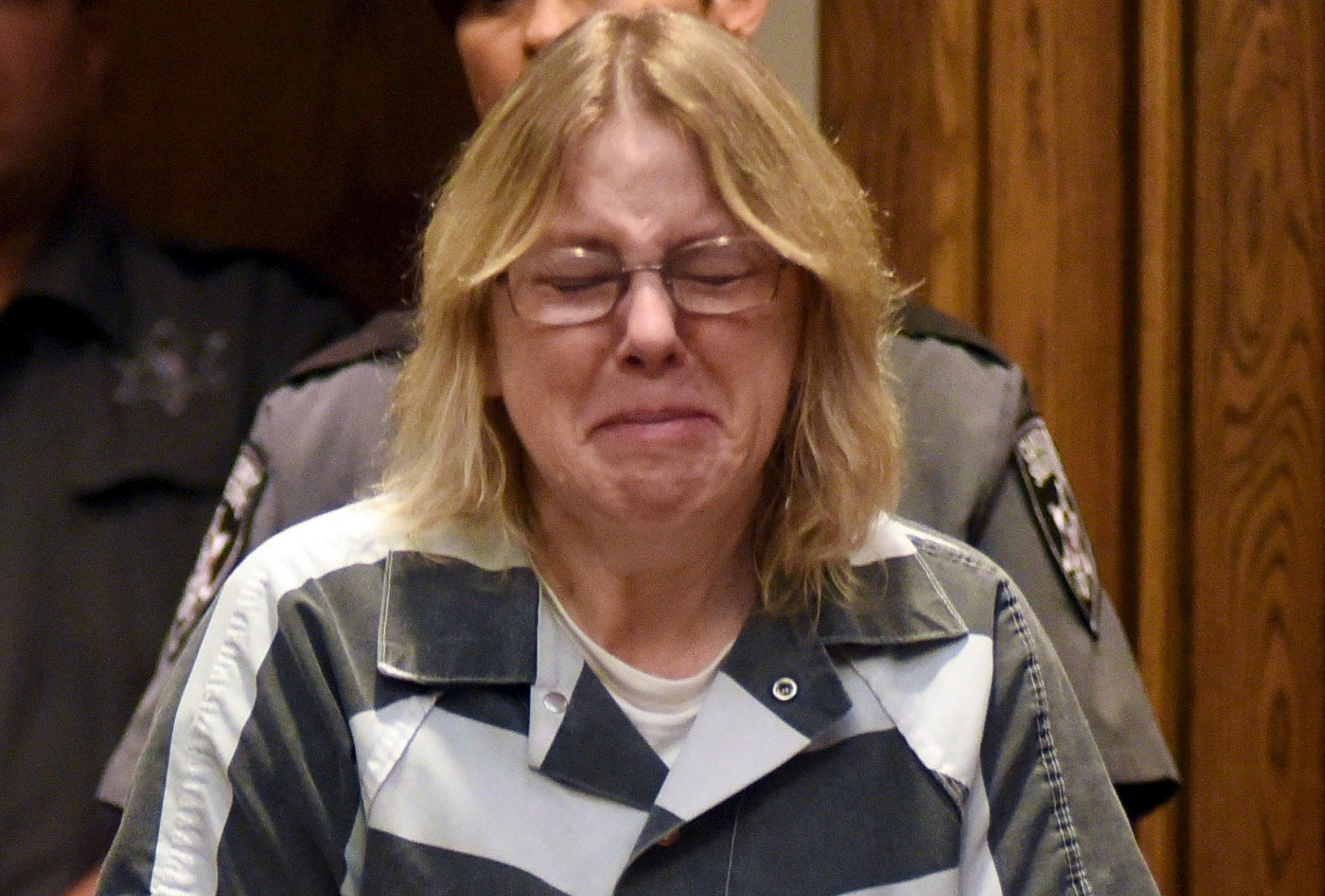 Joyce Mitchell cries during sentencing at Clinton County Court in Plattsburgh, New York.