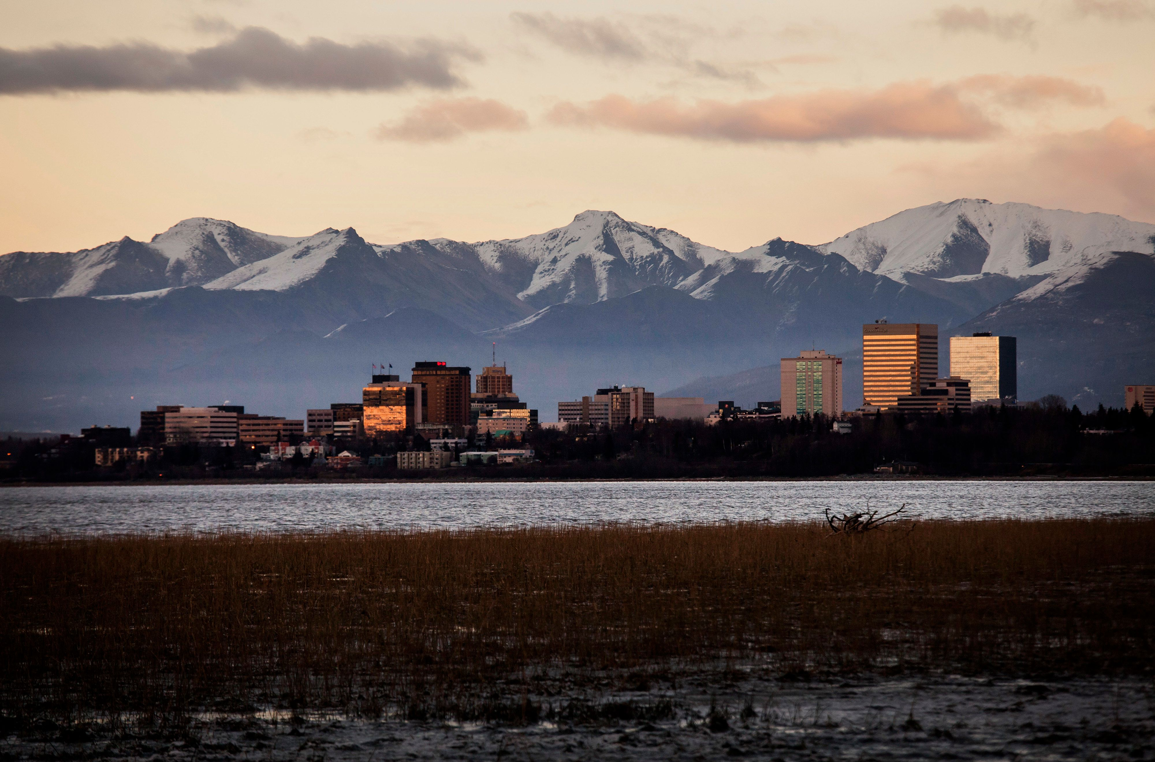 Sunlight reflects off of buildings standing in downtown Anchorage, Alaska, U.S., on Wednesday, Nov. 5, 2014. Voters in Anchorage on Nov. 4 approved a referendum that voids a controversial municipal labor ordinance passed in February 2013. The repeal referendum targeted an ordinance known as AO-37, or the Responsible Labor Act, which eliminated strike rights for most unions, eliminated rights to binding arbitration for police and firefighter unionsgroups that had previously ceded strike rights in exchange for binding arbitrationand limited allowable pay and benefits. Photographer: David Ryder/Bloomberg via Getty Images