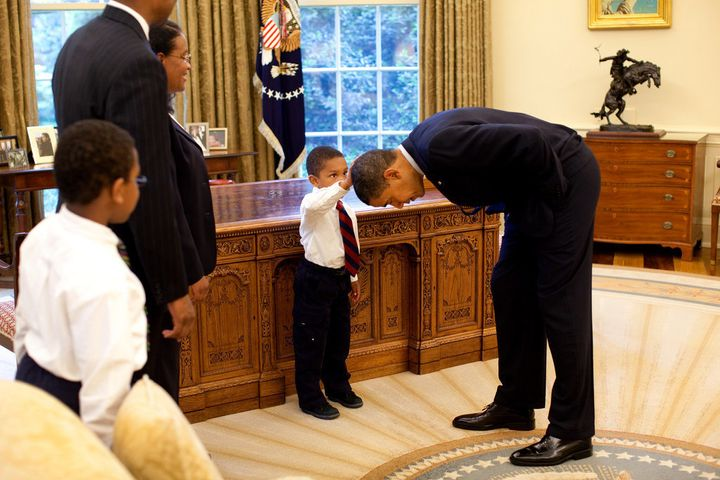 Five-year-old Jacob Philadelphia touches Obama's hair to see if it feels like his.
