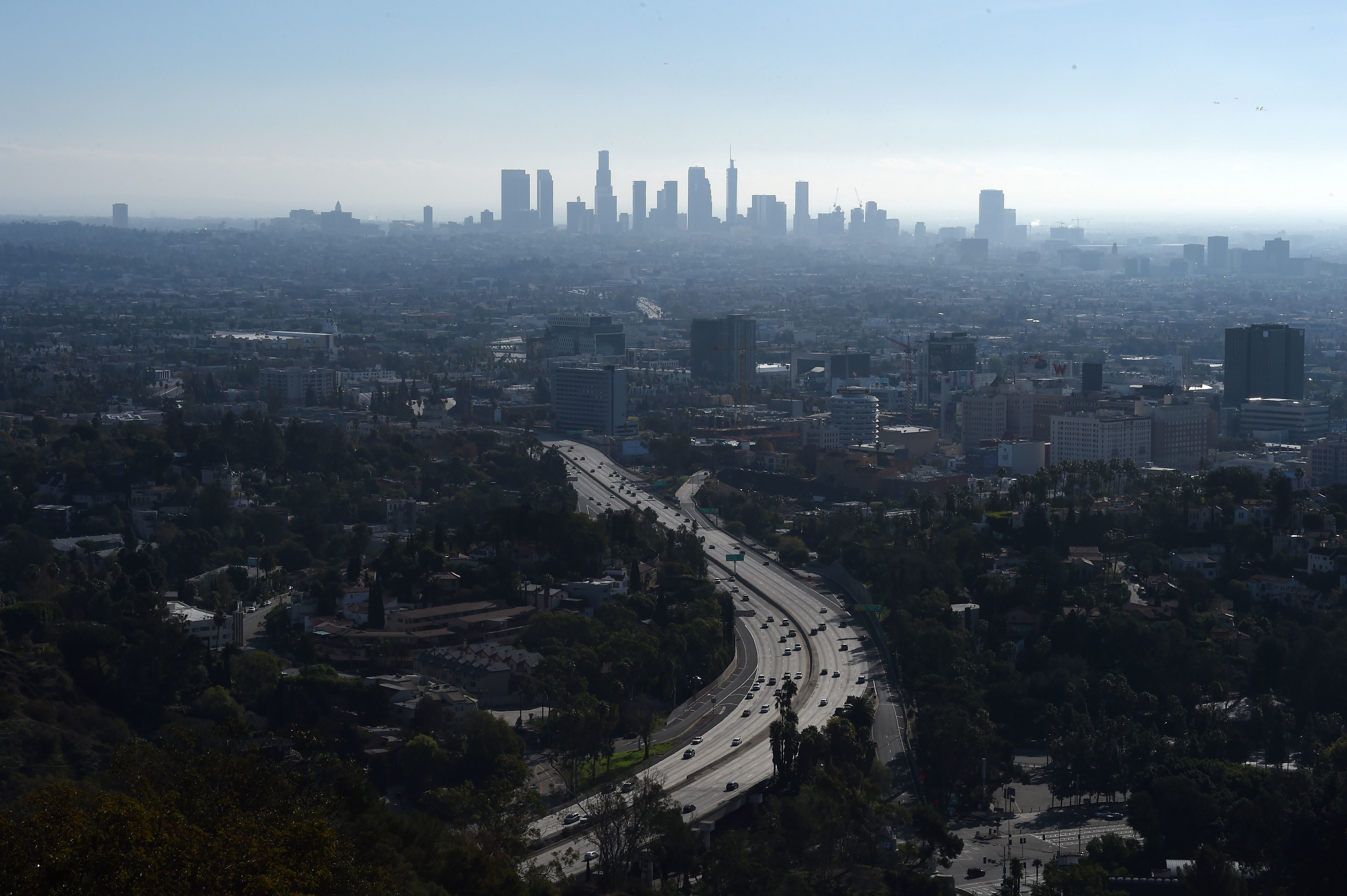 A morning view of downtown Los Angeles with the 101 freeway in the foreground, January 1, 2017 from the Hollywood Bowl Overlook in Hollywood, California. / AFP / Robyn Beck        (Photo credit should read ROBYN BECK/AFP/Getty Images)