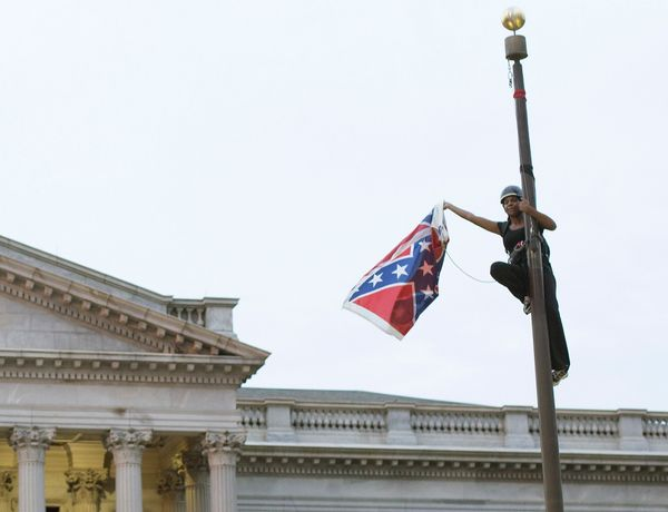 "Brittany ""Bree"" Newsome removes the Confederate flag from a pole at the Statehouse in Columbia, South Carolina, June 27, 2015"