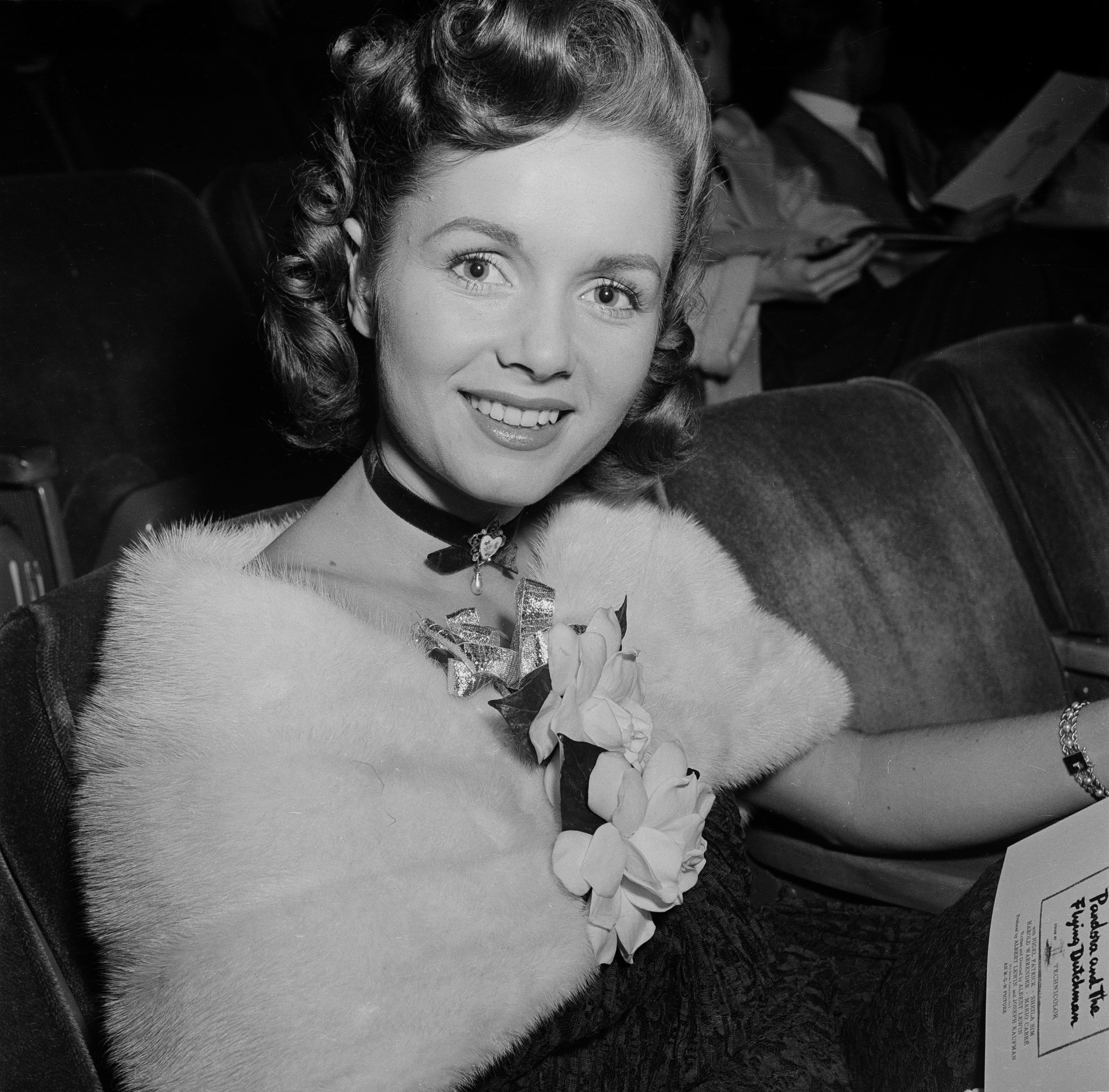 Actress Debbie Reynolds attends a movie premiere in 1952.