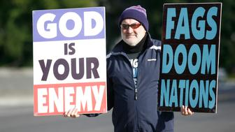 Fred Phelps Jr., a member of Westboro Baptist Church from Topeka Kansas, walks around the US Supreme Court with anti-gay banners on October 6, 2010 in Washington,DC. The Supreme Court Wednesday will examine whether the right to free speech protects a controversial religious group that pickets military funerals displaying signs that read: 'Thank God for dead soldiers.' The Kansas-based Westboro Baptist Church has for years disrupted the funerals of US soldiers killed in Iraq and Afghanistan, claiming the wars are divine punishment because the United States tolerates gays, including in the military. AFP PHOTO/Kimihiro Hoshino (Photo credit should read KIMIHIRO HOSHINO/AFP/Getty Images)