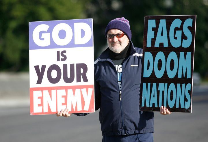 Fred Phelps Jr., a member of Westboro Baptist Church, holds up anti-gay signs while protesting the Supreme Court in 2010. The