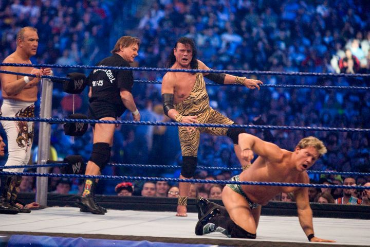 The WWE Hall of Famer is seen entering the ring to fight Chris Jericho during WrestleMania 25 in 2009. Fellow wrestlers Ricky