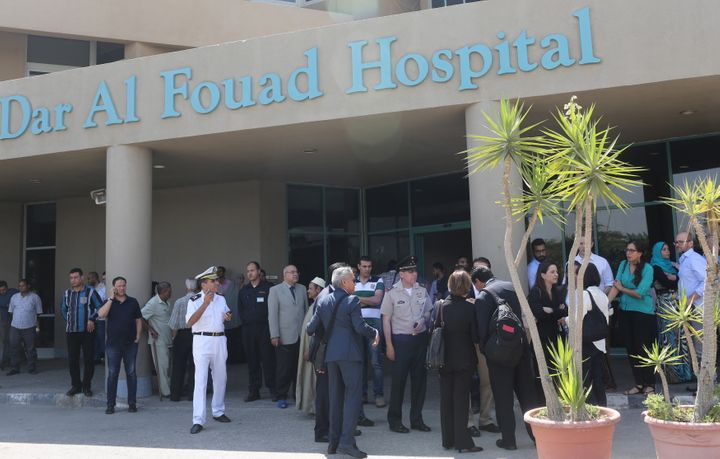 Police and Mexican embassy members stand outside Dar Al Fouad Hospital, where injured tourists who were mistakenly targeted i