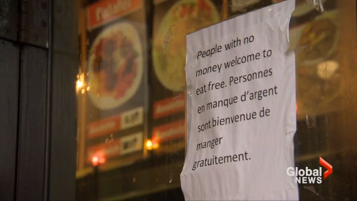 The sign outside Marché Ferdous, written in English and French, offers free food to those with no money.