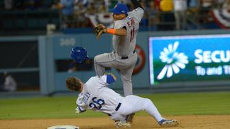 Oct 10, 2015; Los Angeles, CA, USA; New York Mets shortstop Ruben Tejada (11) collides with Los Angeles Dodgers second baseman Chase Utley (26) at second base during the seventh inning in game two of the NLDS at Dodger Stadium. Mandatory Credit: Jayne Kamin-Oncea-USA TODAY Sports