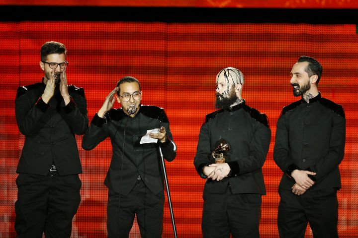 La Vida Boheme accepts the award for Best Rock Album onstage during The 14th Annual Latin Grammy Awards in 2013.