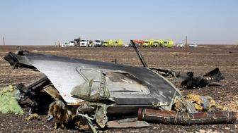 The remains of a Russian airliner are seen at the crash site as rescue crews wait in the al-Hasanah area in El Arish city, north Egypt, November 1, 2015. Rescue teams scoured the area where the Airbus A321 came down on Saturday, collecting into a pile the dead holidaymakers' belongings that were spread around the main part of the wreckage. At least 163 of the bodies have already been recovered from the jet. REUTERS/Mohamed Abd El Ghany