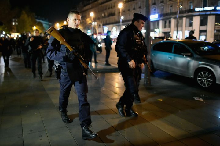 French police patrol at the Place de la République in Paris on Sunday, Nov. 15, 2015.