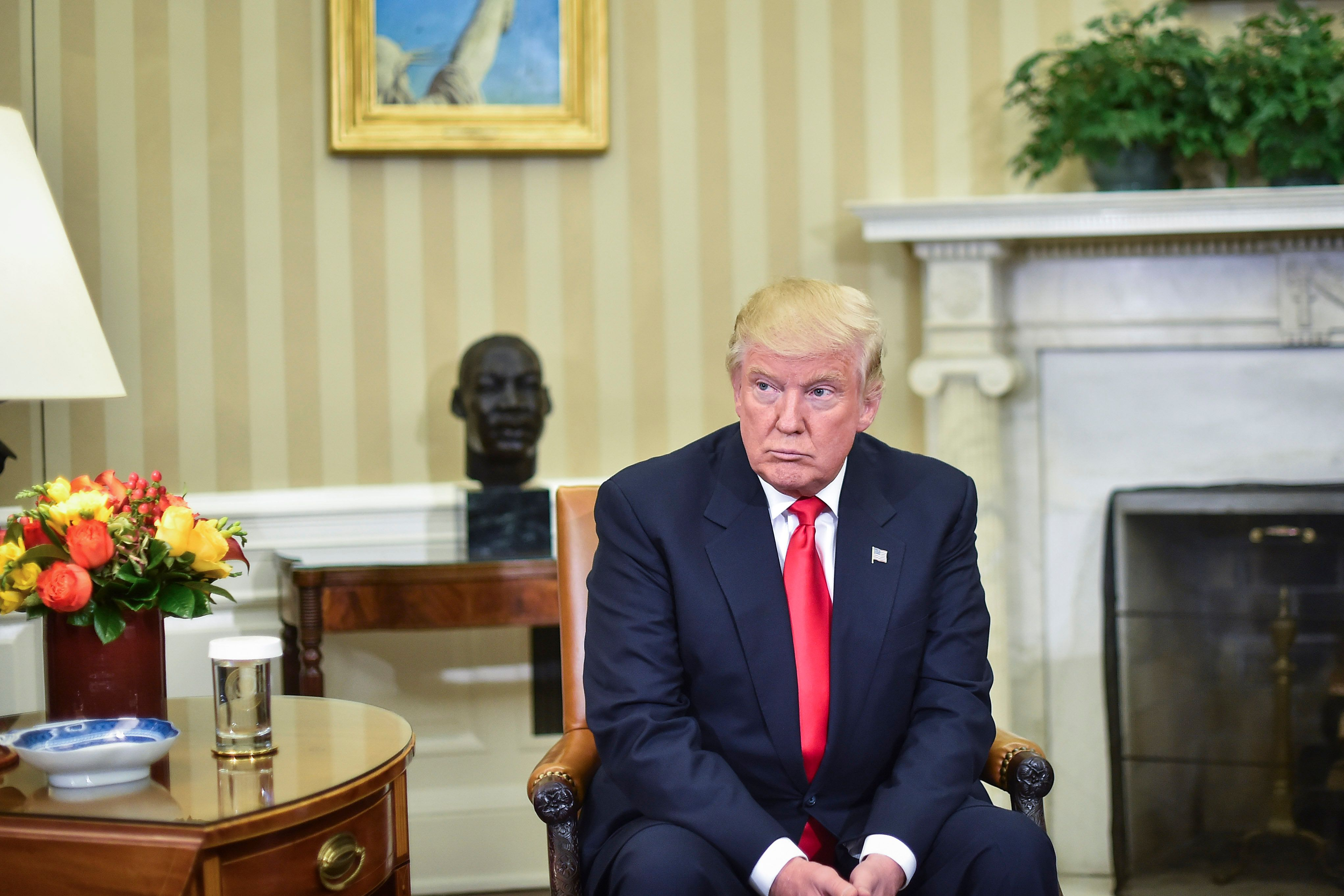 WASHINGTON, DC - NOVEMBER 10: President-elect Donald Trump listens as President Barack Obama talks to the media in the Oval Office of the White House in Washington, Thursday, Nov. 10, 2016. (Photo by Jabin Botsford/The Washington Post via Getty Images)