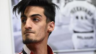 Belgian Taekwondo athlete Mourad Laachraoui, younger brother of Brussels attacks suspect Najim Laachraoui, gives a press conference,on March 24, 2016, at the headquarters of the Francophone Belgian Taekwondo Association in Ukkel/ Uccle, Brussels, two days after a triple bomb attack, claimed by the Islamic State group, hit Brussels' airport and the Maelbeek - Maalbeek metro station, killing 31 people and wounding 270 others.  Mourad Laachraoui 'firmly' condemned his brothers actions saying there had been no contact between the pair since his older brother left Belgium for Syria more than two years ago. / AFP / BELGA / EMMANUEL DUNAND / Belgium OUT        (Photo credit should read EMMANUEL DUNAND/AFP/Getty Images)
