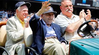 NEW YORK, NY - JUNE 22:  Baseball Hall of Famer and former New York Yankee Yogi Berra is introduced during the teams Old Timers Day prior to a game between the New York Yankees and the Baltimore Orioles at Yankee Stadium on June 22, 2014 in the Bronx borough of New York City.  The Orioles defeated the Yankees 8-0.  (Photo by Jim McIsaac/Getty Images)