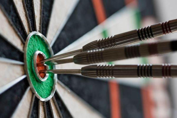 Like shooting pool, darts are a funactivity to do within a bar setting, Syrtash says.