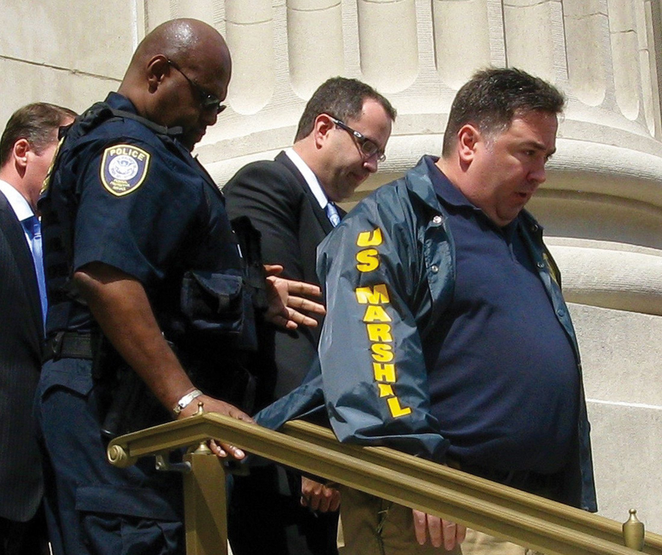Jared Fogle is led from federal court in Indianapolis, Indiana August 19, 2015.  Fogle, the former Subway sandwich chain pitchman asked a federal judge on Wednesday to accept his plea of guilty to charges of child pornography and travelling for illicit paid sex with minors.  REUTERS/Susan Guyett