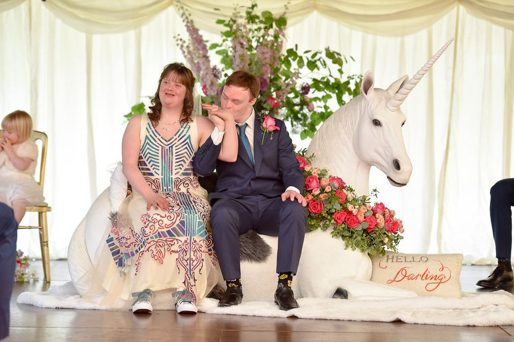 The newlyweds sitting atop their unicorn