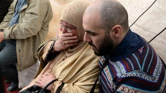Relatives of Moroccan Loubna Lafquiri, who died in the Brussels bombings, mourn on April 3, 2016 during her funeral in the capital Rabat. Loubna Lafquiri died in the suicide bombings that struck the Belgian capital Brussels on March 22, 2016. Brussels Airport reopened with three 'symbolic' flights and strict additional checks for passengers, marking a new high-security era for air travel in Belgium after attacks by Islamic State suicide bombers.  / AFP / FADEL SENNA        (Photo credit should read FADEL SENNA/AFP/Getty Images)