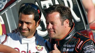 Hummer pilots Robby Gordon (R) of the U.S.A and Qatar's Nasser Al-Attiyah pose at the podium during the departure ceremony of the fourth South American edition of the Dakar Rally 2012 in Mar del Plata December 31, 2011.  REUTERS/Enrique Marcarian (ARGENTINA - Tags: SPORT MOTORSPORT)