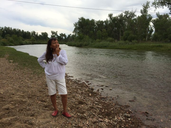Alaina Buffalo Spirit by the Tongue River, which was threatened with pollution from a proposed coal train slated to run adjac