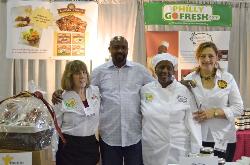 "Herman Nyamunga poses with three ""food entrepreneurs""—Arlene, Jackie, and Hoda—whom he has been coaching."