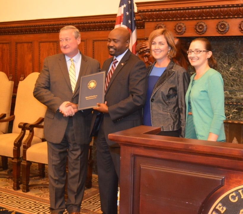 Herman receives a citation from Philadelphia mayor Jim Kenney for his contributions to immigrant entrepreneurship in the city