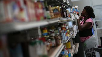 SAN FRANCISCO, CA - MAY 01: A worker stocks shelves with canned goods at the SF-Marin Food Bank on May 1, 2014 in San Francisco, California. Food banks are bracing for higher food costs and an increased demand for food from the needy as food prices are skyrocketing due to a reduction in food stamps and drought conditions in several states. (Photo by Justin Sullivan/Getty Images)