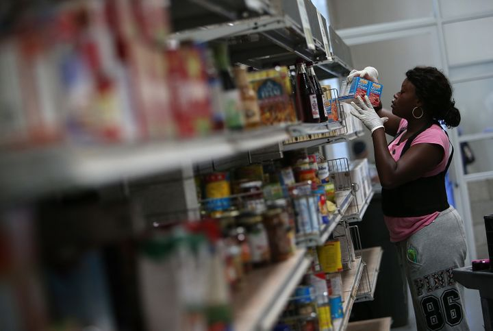 A worker stocks shelves with canned goods at the SF-Marin Food Bank in San Francisco, California. Food banks could becom