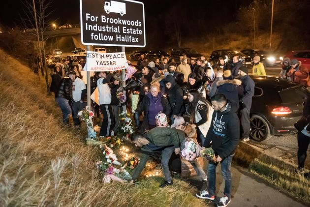 Mourning friends and family hold a vigil at Jct 24 of the M62 near Huddersfield, West