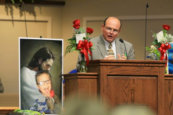 Tim Marcengill, Associate Pastor Evangelism and Education, speaks at the funeral for 6-year-old Jacob Hall at the Oakdale Bap