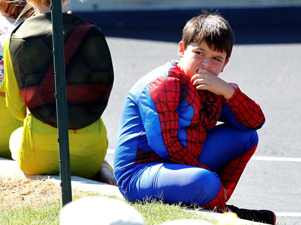 A young boy dressed as spiderman watches as the casket of Jacob Hall leaves Oakdale Baptist church in Townville, South Caroli
