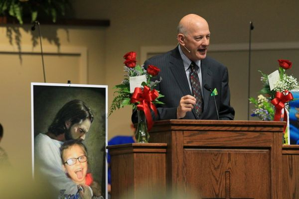 Rev. David Blizzard, Senior Pastor, speaks at the funeral for 6-year-old Jacob Hall at the Oakdale Baptist Church in Townvill