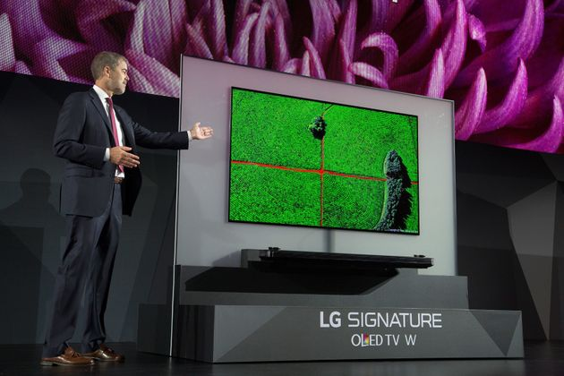 LG's 4K OLED TV Is So Paper Thin It Is Making Our Brain