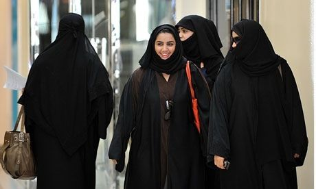 Saudi women walk inside the Faysalia shopping center in Riyadh, the capital.