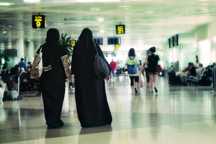 Women walking at the old airport in Doha, Qatar.