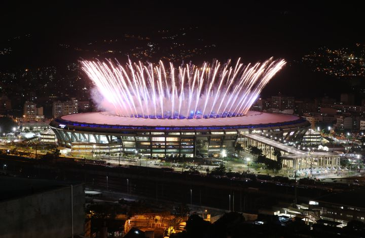 Rio de Janeiro's famed Maracanã stadium, built in 1950, lights up with fireworks for the opening ceremony of