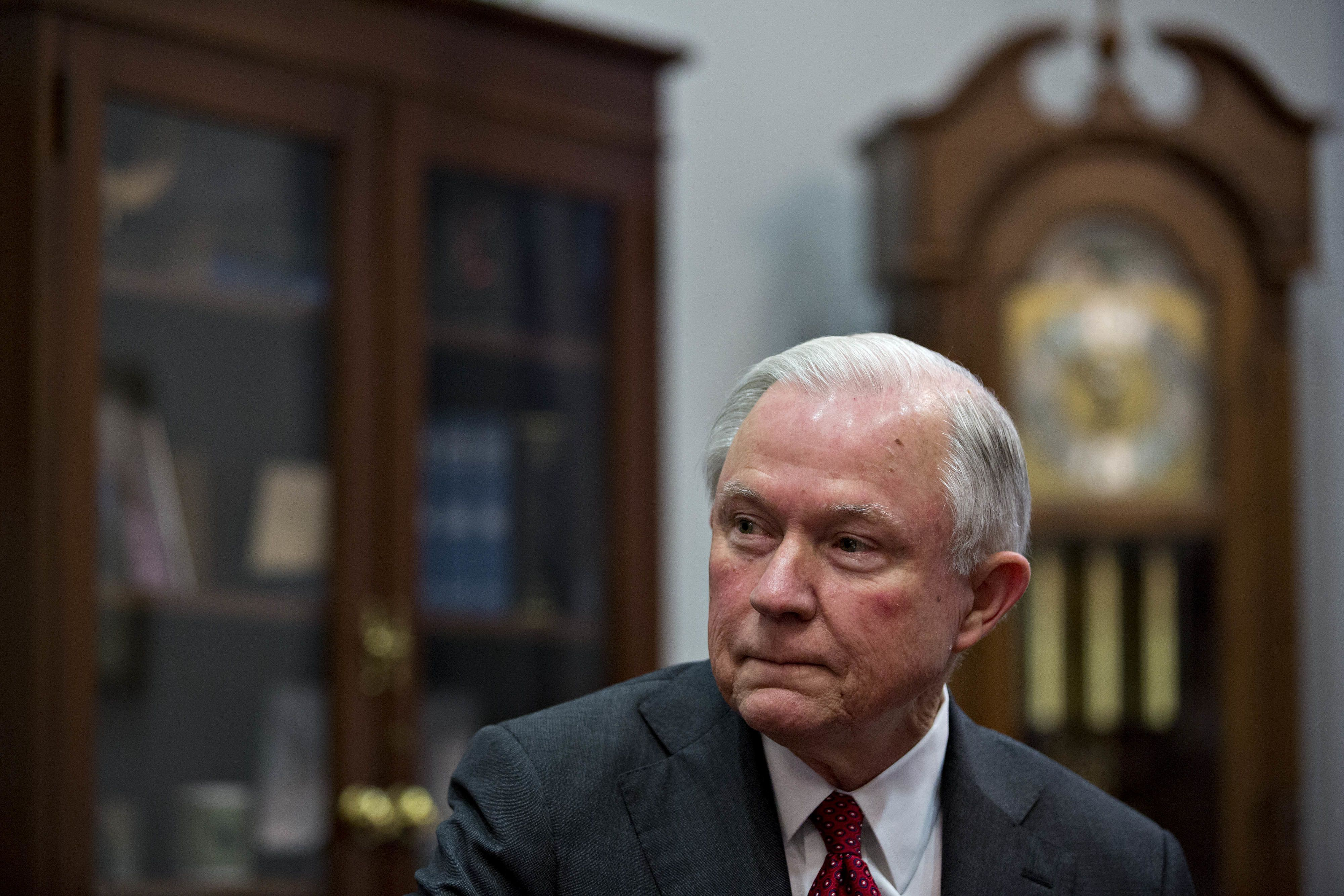 Senator Jeff Sessions, attorney general pick for U.S. President-elect Donald Trump, listens as Senator Charles 'Chuck' Grassley, a Republican from Iowa, not pictured, speaks during a meeting in Washington, D.C., U.S, on Tuesday, Nov. 29, 2016. Sessions, the 69-year-old, four-term Alabama Republican is a hard-liner on free trade and immigration, arguing that prospective immigrants dont have constitutional protections. Photographer: Andrew Harrer/Bloomberg via Getty Images