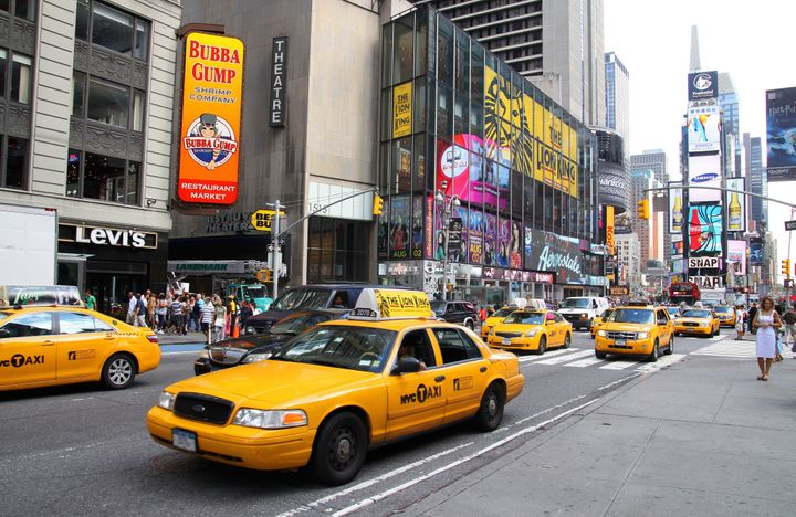 Yellow cabs travel south on Broadway in Times Square in New York.