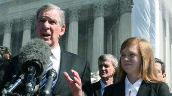 WASHINGTON, DC - OCTOBER 10:  Attorney Bert Rein (L), speaks to the media while standing with plaintiff Abigail Noel Fisher (R), after the U.S. Supreme Court heard arguments in her caseon October 10, 2012 in Washington, DC. The high court heard oral arguments on Fisher V. University of Texas at Austin and are tasked with ruling on whether the university's consideration of race in admissions is constitutional.  (Photo by Mark Wilson/Getty Images)