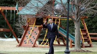 WASHINGTON - MARCH 06:  U.S. President Barack Obama walks past a new swing set as he departs the White House for Marine One on March 6, 2009 in Washington, DC. Obama is traveling to Ohio to attend the Columbus police's graduation ceremony. The recruit class' new jobs are owed to the President's economic recovery bill.  (Photo by Mark Wilson/Getty Images)