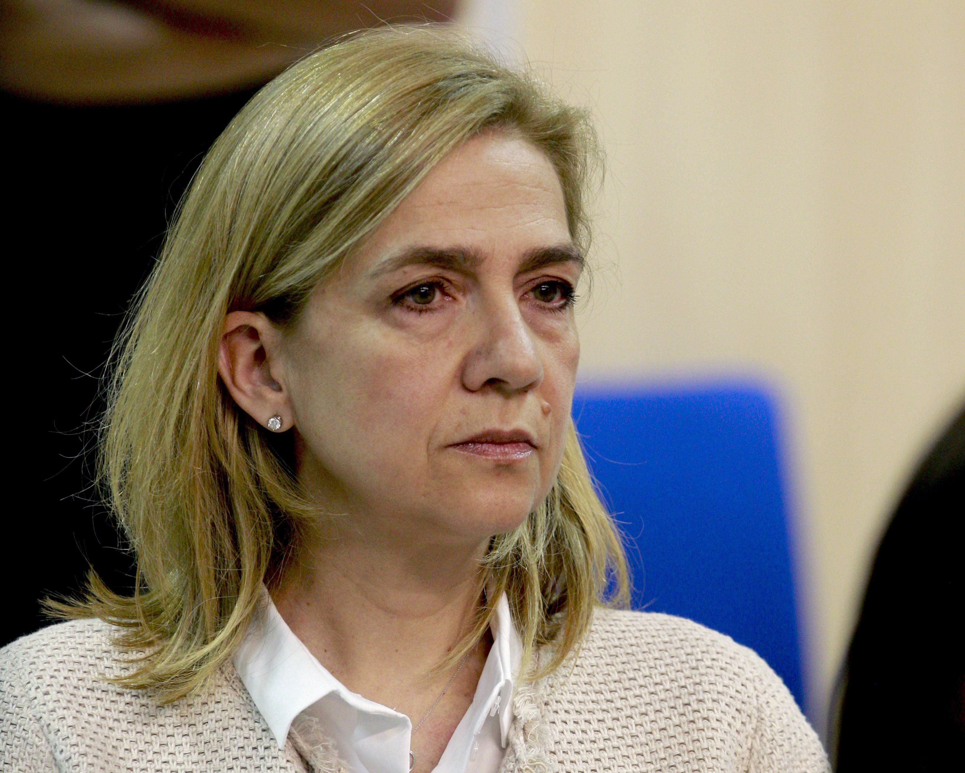 Spain's Princess Cristina sits during a hearing held in the courtroom at the Balearic School of Public Administration (EBAP) building in Palma de Mallorca, on the Spanish Balearic Island of Mallorca on June 10, 2016. Spanish prosecutors called today for the king's brother-in-law to be given a 19-and-a-half year jail term for alleged embezzlement in a trial that has also seen his wife Princess Cristina accused of tax evasion. The princess and her husband Inaki Urdangarin are among 17 suspects who went on trial in January as part of a case that involves business dealings by the Noos Institute, a not-for-profit organisation based in Palma which Urdangarin founded and chaired from 2004 to 2006.     / AFP / POOL / Ballesteros        (Photo credit should read BALLESTEROS/AFP/Getty Images)