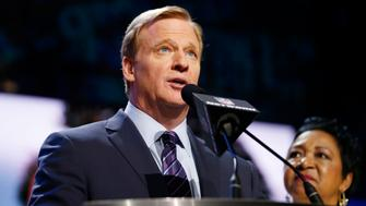 Apr 28, 2016; Chicago, IL, USA; NFL commissioner Roger Goodell (left) and Connie Payton announce the number eight overall pick in the first round of the 2016 NFL Draft to the Chicago Bears at Auditorium Theatre. Mandatory Credit: Kamil Krzaczynski-USA TODAY Sports